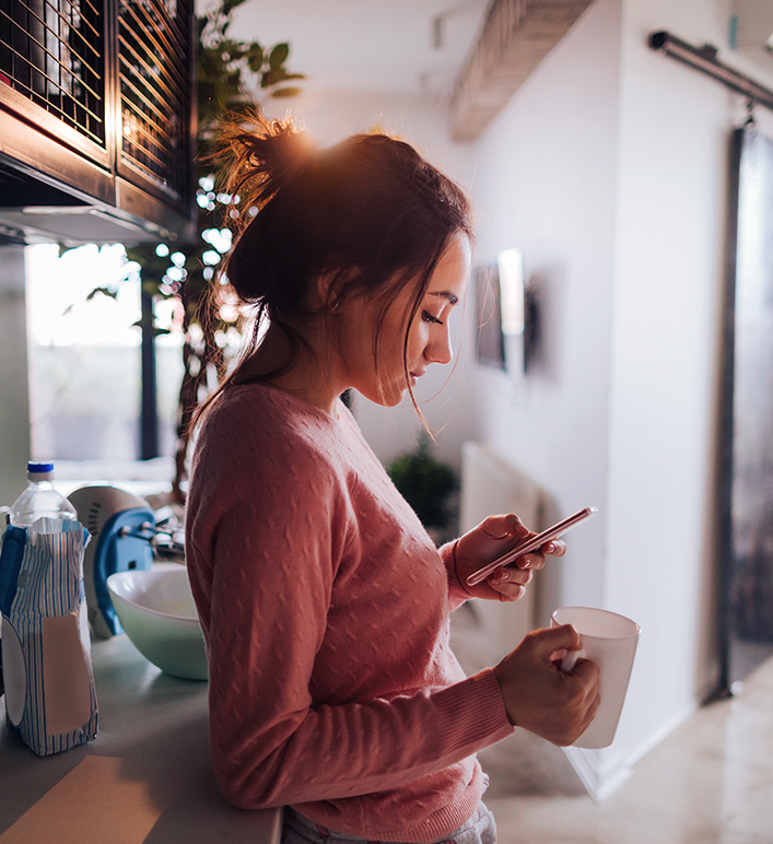 Woman on smart phone at home