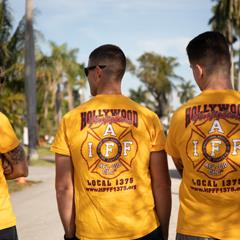 Firefighters with team shirts